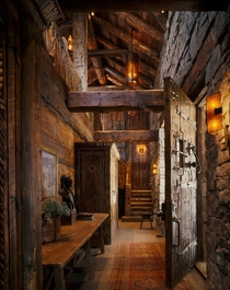 Cabin Entry Reclaimed Beams amp Large Scale Proportions emphasize Strong Rustic Warmth Peace Design