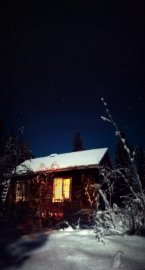 Cabin in The Cold Winter Night Lapland Finland
