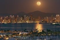 California USA The moon rises over San Diego harbor on a serene and peaceful night writes photographer Dwayne Andrejczuk