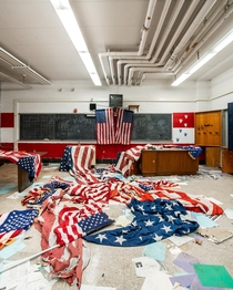 Came across dozens of American flags scattered all over the floor inside this abandoned inner city high school