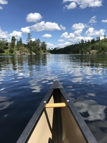 Canoeing on Saganaga Lake in the Boundary Waters MN USA