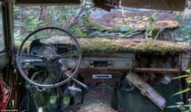 car graveyard where US soldiers hid their cars after WWII hoping to ship them home to america Chtillon Belgium