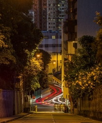 Cars zipping through the hills of Macau  by Tristan OTierney