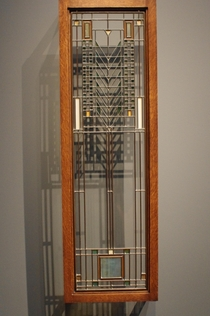 Casement window Frank Lloyd Wright design c  Leaded glass panes in metal frame Linden Glass Company maker Made for Darwin D Martin House Buffalo New York  Displayed in Cleveland Museum of Art