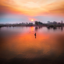 Casting his net at sunset in Laos Photo credit to Simon Matzinger