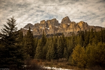 Castle Mountain just before golden hour With a hint of the sun illuminating across the face Alberta Canada