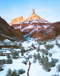 Castleton Tower centerpiece of Castle Valley Utah Love the contrast of winter on these red rocks
