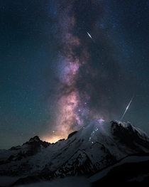 Casually night climbing to the peak of the tallest volcano in the Pacific Northwest under the Milky Way and falling space particles Mt Rainier Washington