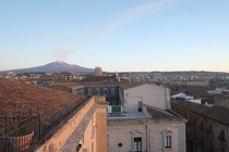 Catania Sicily Italy at Daybreak with Mt Etna smoking in the distance