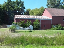 Cessna A with its wings detached near a barn C-FJPA Chatham-Kent ON