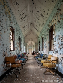 Chairs in a hallway in an abandoned asylum