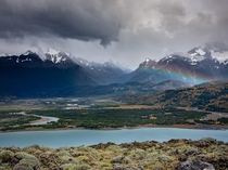Changing weather created a rainbow in a beautiful valley in Torres del Paine Chile OC x