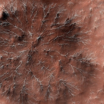 Channels created by carbon dioxide frost on Mars