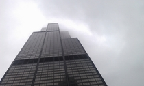 Chicago Sears Tower disappearing into the low clouds this morning