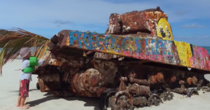 Child playing around an abandoned sherman tank on Flamenco Beach Puerto Rico