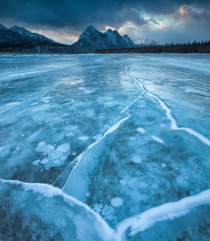Chilling Alberta frozen lake and beautiful mountains