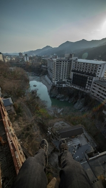 chilling on the roof at an abandoned hotel in japan