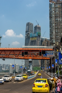 Chongqing China with Raffles city under construction in the background by SSC user noisrevid