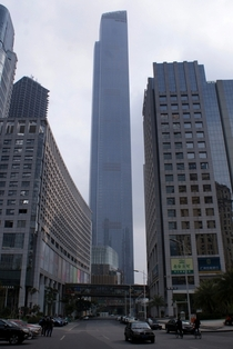 Chow Tai Fook Centre Towering Over Street in Guangzhou China