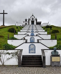 Church and steps made from volcanic lava rock and white plaster with azulejo tile murals in Sao Miguel Azores