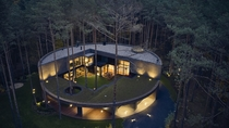 Circlewood House in Warsaw Poland - made out of wood in the shape of a perfect circle