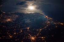 City Lights at Night along the France-Italy Border Moonglint and the lights of Torino Lyon and Marseille glitter in this nighttime astronaut photo of the Italy-France border region Earth photographed on  April  from the International Space Station Photo c