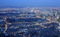 Cityscape of downtown Seoul South Korea seen from Mt Inwang with Gyeongbok Palace in the middle