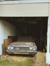 Classic Chevy rotting in a garage in Carlisle PA