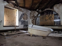 Clawfoot tub inside an abandoned New England mansion