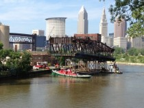 Cleveland - Historic lift bridge span cut away and floating down the Cuyahoga River x