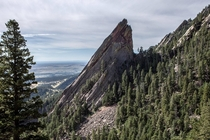 Climber reaches top of Flatiron  Boulder CO