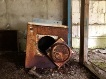 Clothes dryer in front of an abandoned apartment