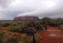 Cloud over Uluru Australia  Photograph by Warren Brown