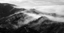 Cloud rolls over the hills on Catalina Island