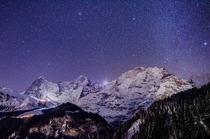 Cloudless winter sky packed with stars over the giant Eiger Mnch and Jungfrau - Lauterbrunnen Switzerland