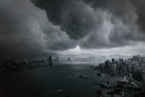 Clouds build up over the Victoria Harbor before a storm in Hong Kong
