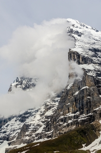Clouds clinging to the mile-high north face of the Eiger - Kleine Scheidegg Switzerland