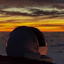 Clouds Comet and Crescent Moon seen from the William Herschel Telescope in the Canary Islands