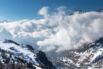 Clouds filling the valley in Alpe DHuez France