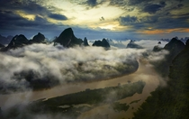Clouds hang low above the Li River China  by Thierry Bornier x-post rChinaPics