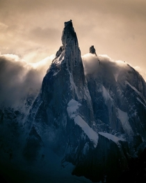 Clouds rolling over the distinctive peak of Cerro Torre in Patagonia