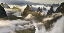 Cloudscape among the Yangshuo mountains of China  photo by Thierry Bornier
