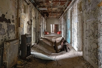 Collapsed floor in abandoned mental asylum