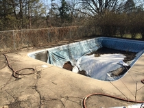 Collapsed pool My dad drained the water out of his pool a few years ago and then just never touched it again