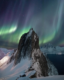 Colorful aurora over the fjords Troms Norway