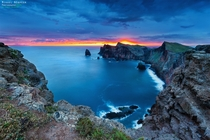 Colorful sunset at a cliff at Canial Madeira Island Madrid Portugal by Miguel Nbrega