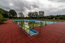 Colourful outdoor pool on the site of an abandoned barracks Germany