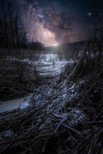 Composite of the Milky Way over a frozen lake