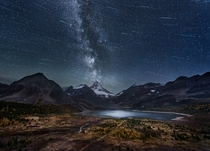 Composited starscape over Mount Assiniboine in British Columbia Canada  by Adam Gibbs