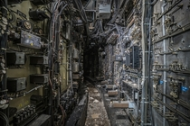 Computer wiring tunnel inside an abandoned coal power plant   By Bryan Buckley